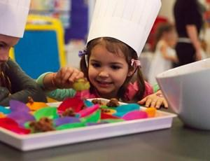 Child making cakes at Clownfish Club on Hamilton Island