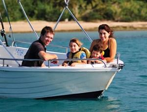Family on a dinghy hire on Hamilton Island