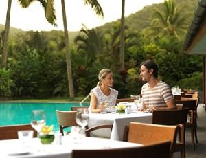 Couple dining at Pool Terrace restaurant on Hamilton Island