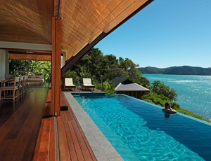 Luxury beach house dining room and lap pool at qualia