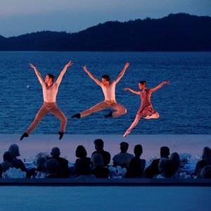 Pas de Deux Dancers performing at dusk on Hamilton Island luxury resosrts