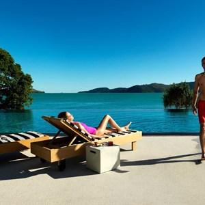 Couple enjoying the private Pebble Beach pool at qualia