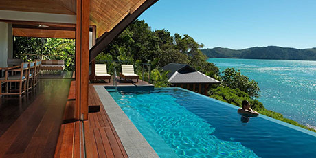 Luxury beach house dining room and lap pool at qualia, Hamilton Island - perfect destination for your tropical holiday
