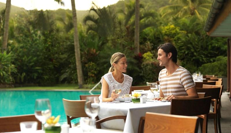 couple eating breakfast at pool terrace restaurant