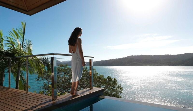 Woman by the private Windward Pavilion plunge pool at qualia