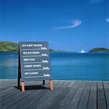 Board with fun water activities on Hamilton Island, Australia