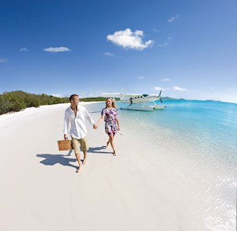Couple walking on Whitehaven Beach