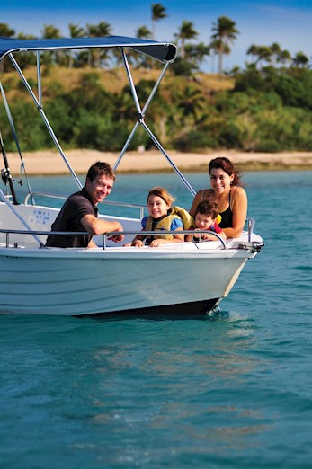 Family on a dinghy hire on Hamilton Island, Queensland