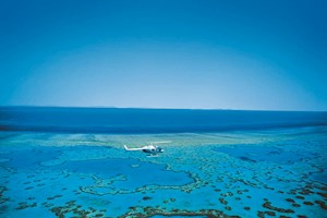 Helicopter flying over the Great Barrier Reef, Australia