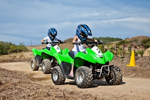 Kids having fun with quad bikes on Hamilton Island