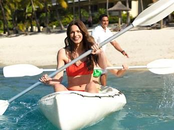 Woman on kayak off catseye beach
