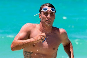 Ky Hurst swims in the Hamilton Island Endurance Series while enjoying his Whitsunday Island resort, Great Barrier Reef accommodation and Whitehaven Beach.
