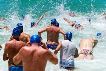 Swimmers taking part in the Hamilton Island triatlon - a famous sporting event in the Whitsunday Islands visited annually by many people who have chosen to spend their summer vacation there