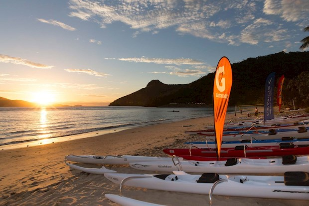 Kayaks on Clash of the paddles at sunset on Hamilton Island -