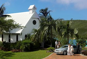 Wedding couple in front of the All Saints Chapel on Hamilton Island