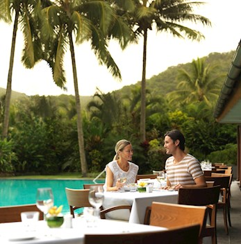 Lovely outdoor dining at Pool Terrace restaurant for your romantic gateway on Whitsunday resorts