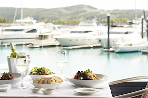 Waterfront dining at Romanos Restaurant on Hamilton Island