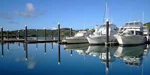 Luxury yachts on Hamilton Island's Marina. Enjoy  an amazing tropical holiday with Hamilton Island