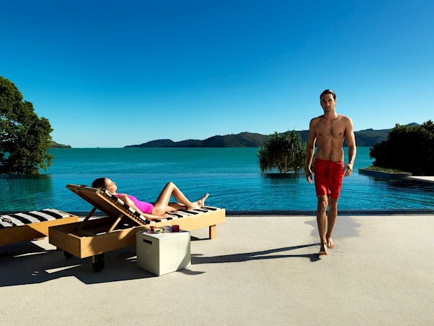 Couple enjoying the private Pebble Beach pool at qualia. Hamilton Island offers amazing holiday specials for your family vacation or romantic gateways