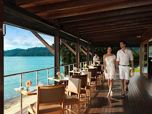 Couple enjoying a romantic lunch at Pebble Beach restaurant, Hamilton Island