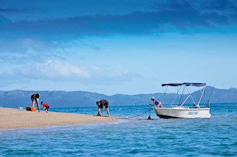 Hire a dingy to explore the Great Barrier Reef - Hamilton Island family holiday