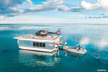 Journey to the Heart. Heart Reef and Heart Island pontoon helipad © Hamilton Island, SaltyWings
