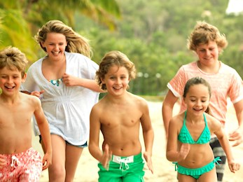 Kids playing on the beach - Hamilton Island holidays with kids