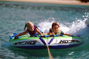 Family fun on the water hiring a tube - family packages Hamilton Island