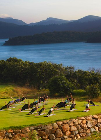Unwind with yoga on spectacular Dent Island - Hamilton Island luxury resorts