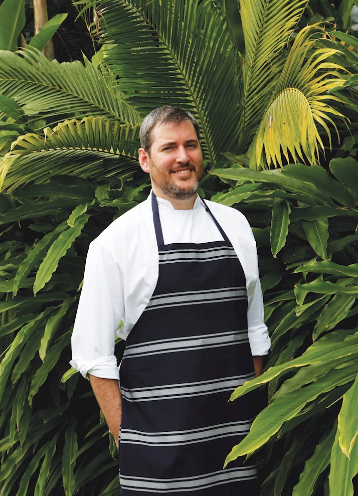 Adam Woodfield, chef at Whitsunday Island resort restaurant, coca chu – a popular choice among people enjoying Queensland family holiday packages.