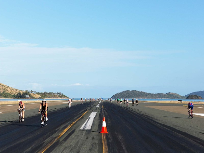 Hamilton Island triathlon cycling down the runway
