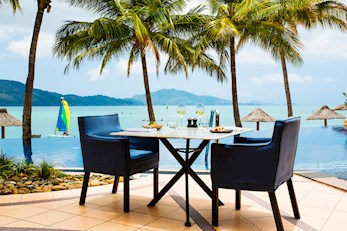 Enjoy breakfast by the pool - Holiday Beach Club holiday packages Hamilton Island