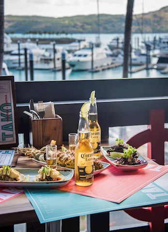 Mexican food and beers over looking the harbour at TAKO's - Hamilton Island resort