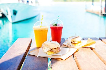 Enjoy a light lunch at the Marina Cafe - Hamilton Island babymoon