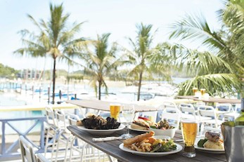 Enjoy delicious meals at the Marina Tavern - Hamilton Island resort