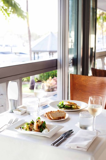 Relax with a beautiful meal at Mariners - Hamilton Island honeymoon