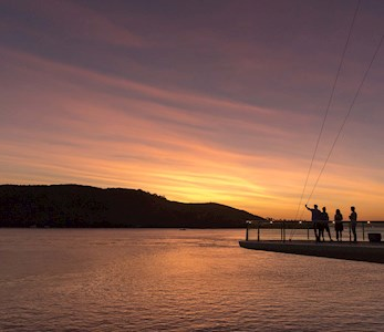 Watch the sunset from Bommie Deck at the Yacht Club - Hamilton Island family holidays
